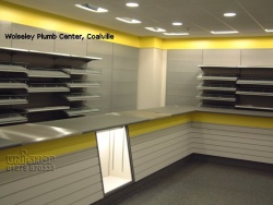 Plain Shelving and Slatwall Retail Counter at Wolseley Plumb Center, Coalville
